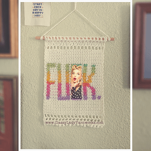 "Crocheted wall art that says ""Fuck."" Represents a crochet pattern that is available from Classy Lady Yarnworks"